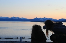 Emma and Zoe watching whales from the helicopter pad during a late Alaskan Sunset